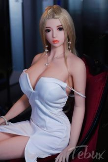 blonde Full Size Sex Dolls in short white dress sitting in a chair