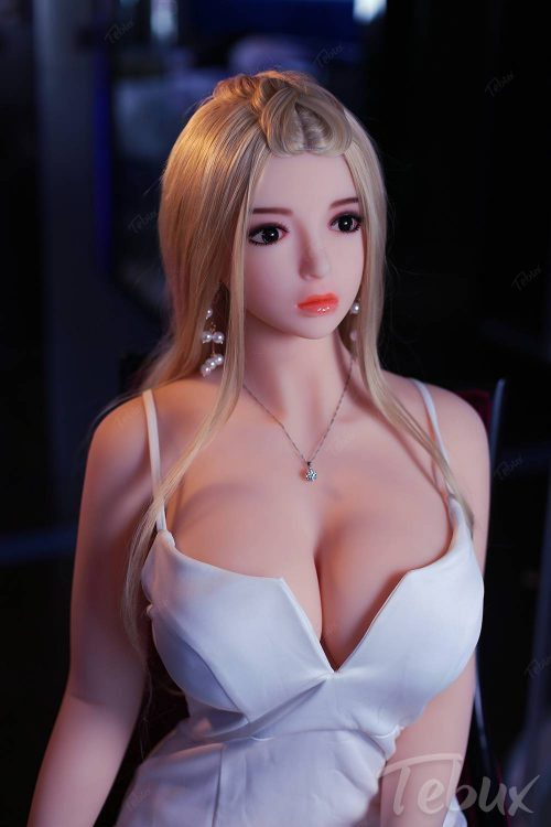 Full size sex doll Alexia sitting in white dress