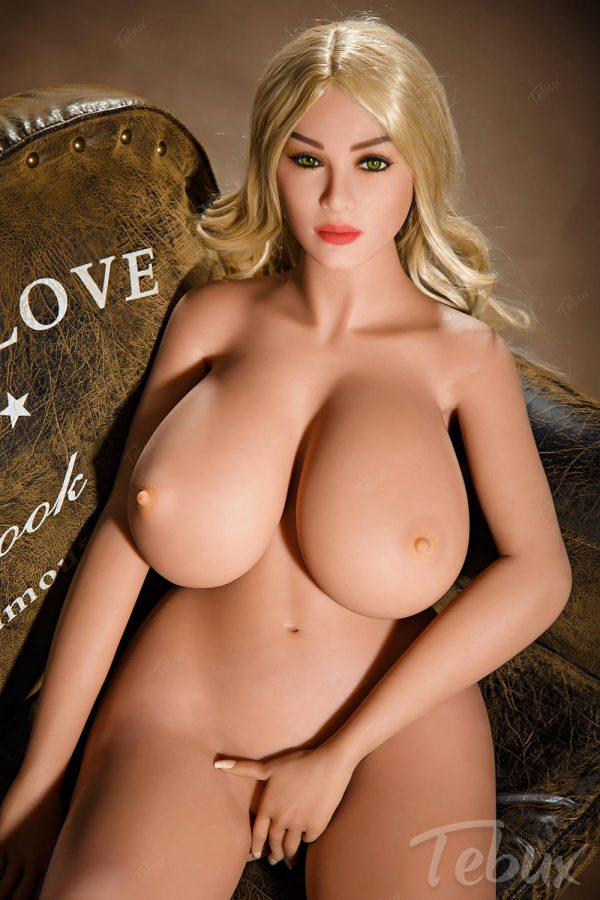 Huge tits sex doll lying down naked