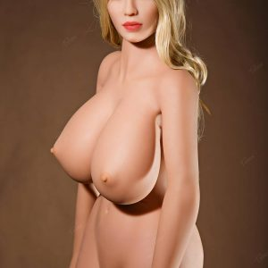 Huge tits sex doll sitting naked