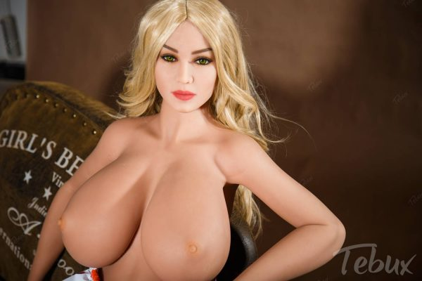 Huge tits sex doll sitting topless