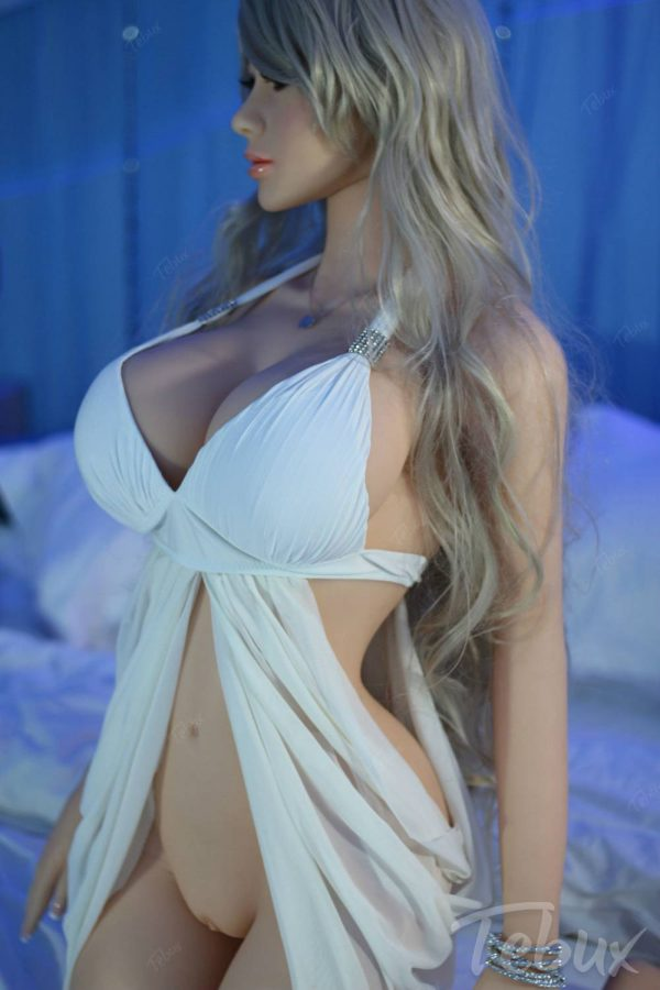 Life like sex doll sitting wearing dress