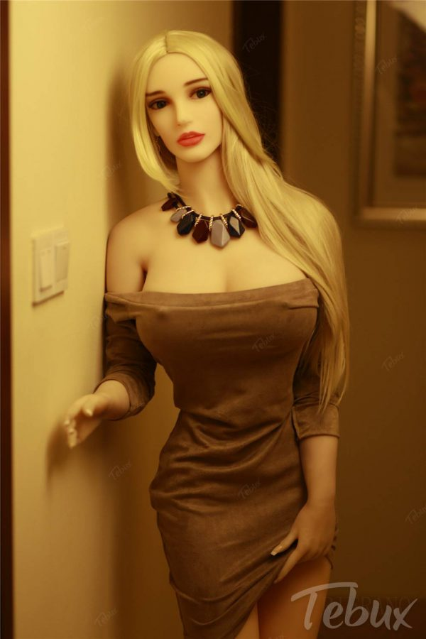 Tebux Sex Doll with blonde hair and short brown dress