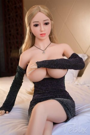 blonde Real Life Sexdolls covering her big boobs wearing a short black soft dress
