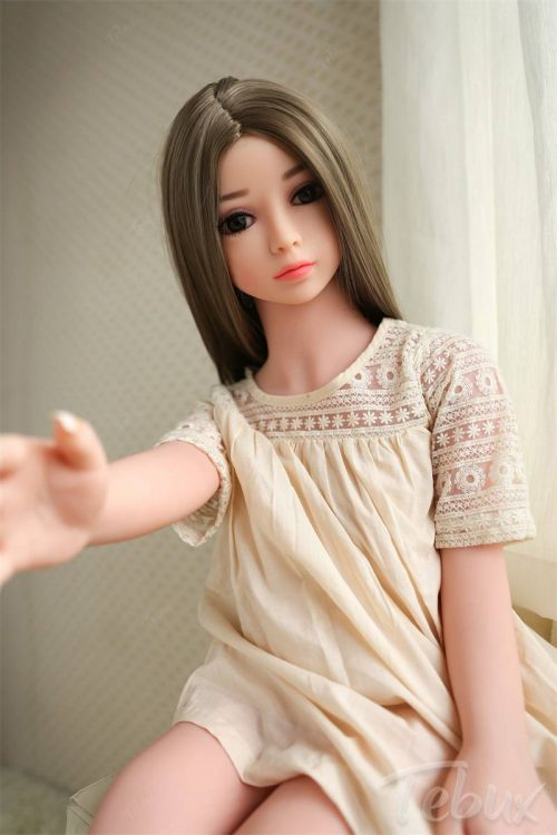 brunette teen 100cm Sex Dolls in pyjama holding out her hand