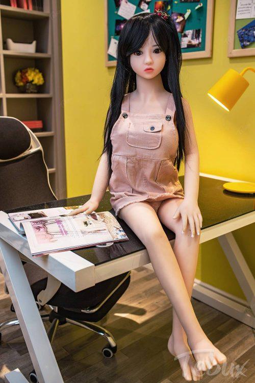 Asian love dolls like Savannah sitting in dress