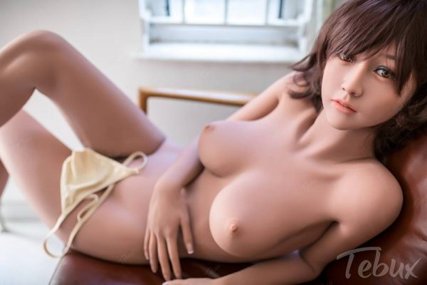 Asian sexdoll Michaela lying naked on chair