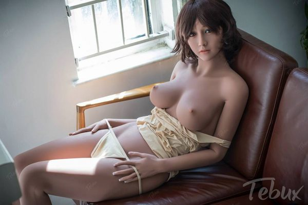 Asian sexdoll Michaela sitting on chair in lingerie