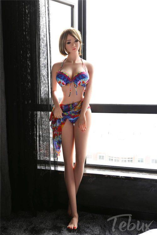 Asiansexdoll standing wearing bikini