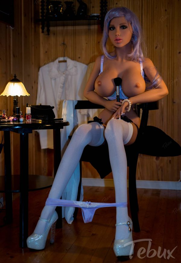 Big boobs doll Nola sitting naked