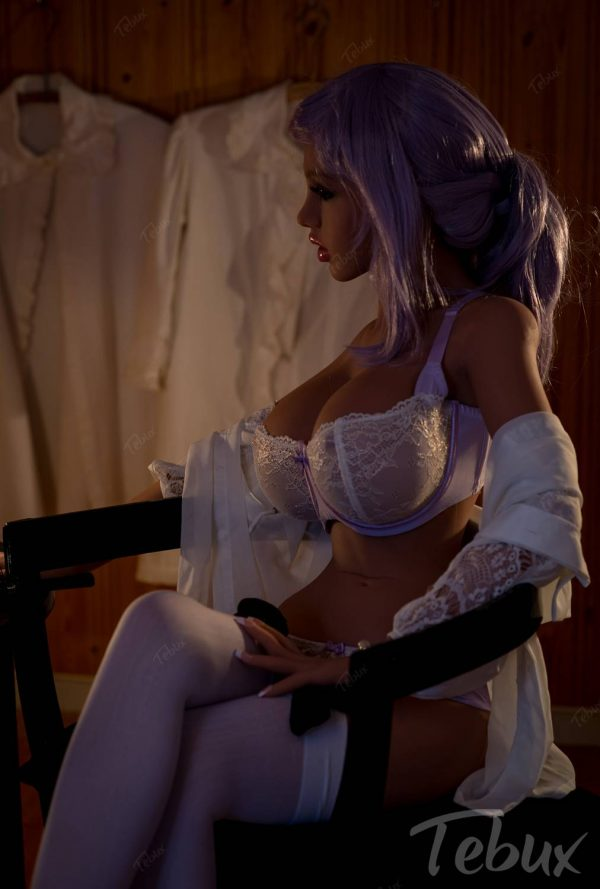 Big boobs doll Nola sitting in lingerie