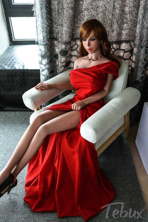 Big boobs sexdoll Meredith sitting wearing red dress