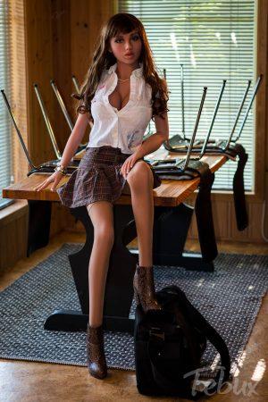 Big sex doll Sariah sitting in short skirt