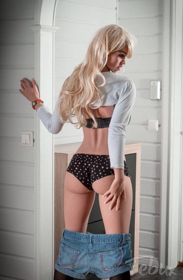 Blonde sex doll Ellen standing up in black lingerie