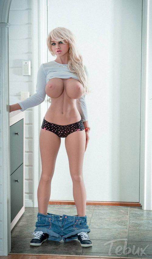 Blonde sex doll Ellen standing up topless