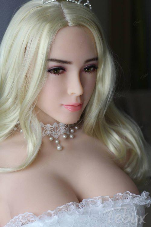 Buying a sex doll like Jazmine sitting wearing a white dress
