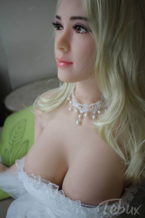 Buying a sex doll like Jazmine sitting topless