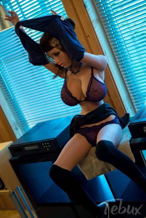 Chubby sex doll Simone sitting down in lingerie