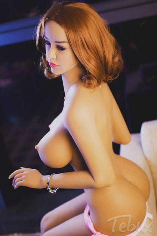 Curvy sex doll sitting topless