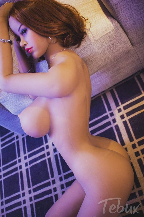 Curvy sex doll lying naked