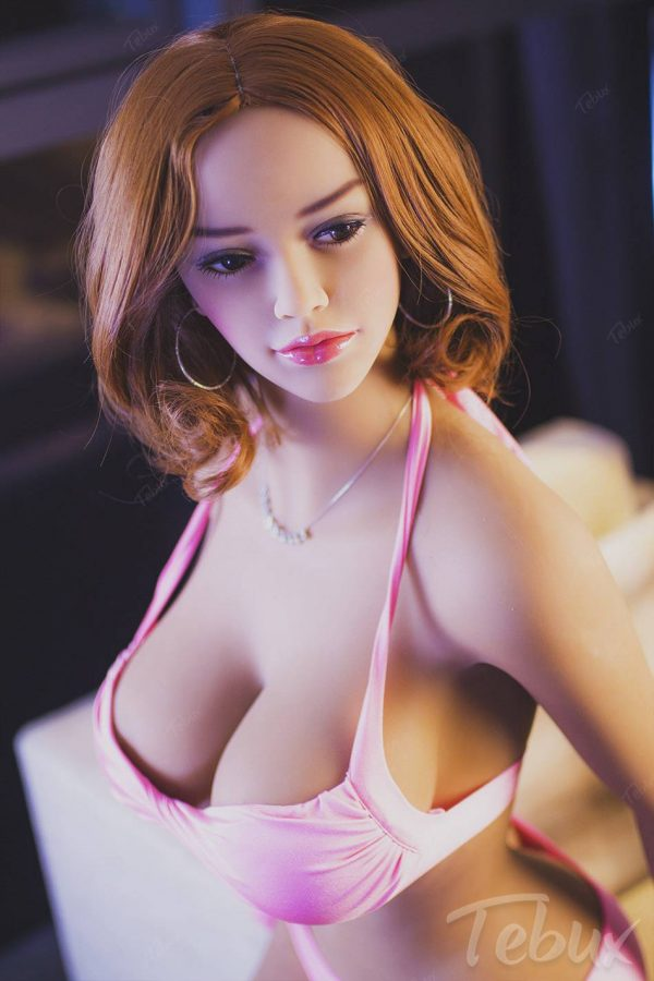 Curvy sex doll sitting wearing pink lingerie