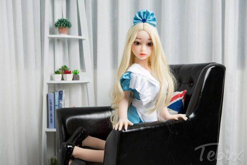 Flat chest sex dolls like Penelope kneeling in dress