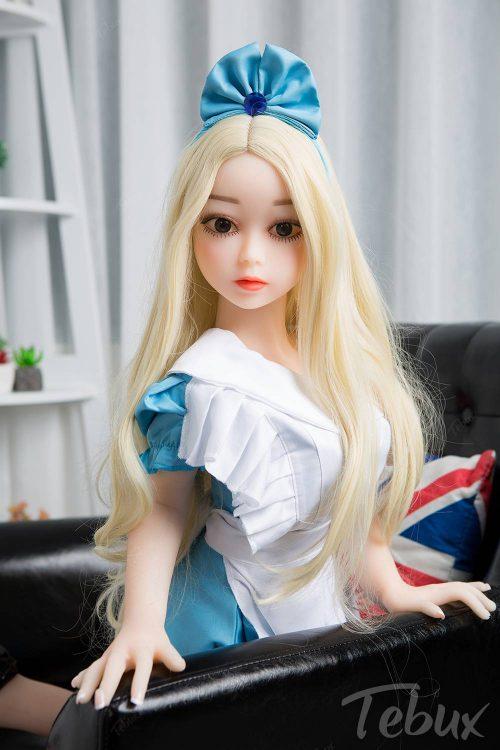 Flat chest sex dolls like Penelope sitting in dress