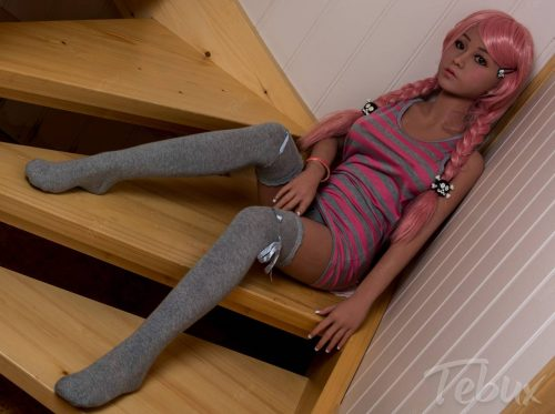 High-quality sex doll sitting on stairs wearing long socks