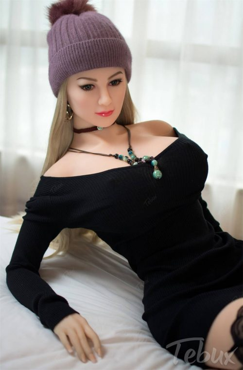 Hot sex doll Allyson wearing black dress lying down