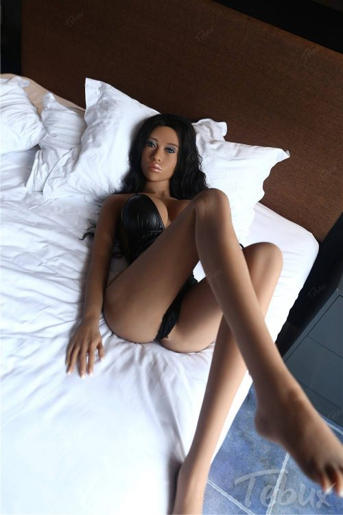 Latina sex doll lying in black lingerie