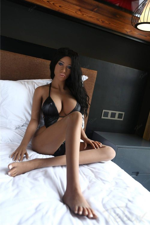 Latina sex doll sitting in black lingerie