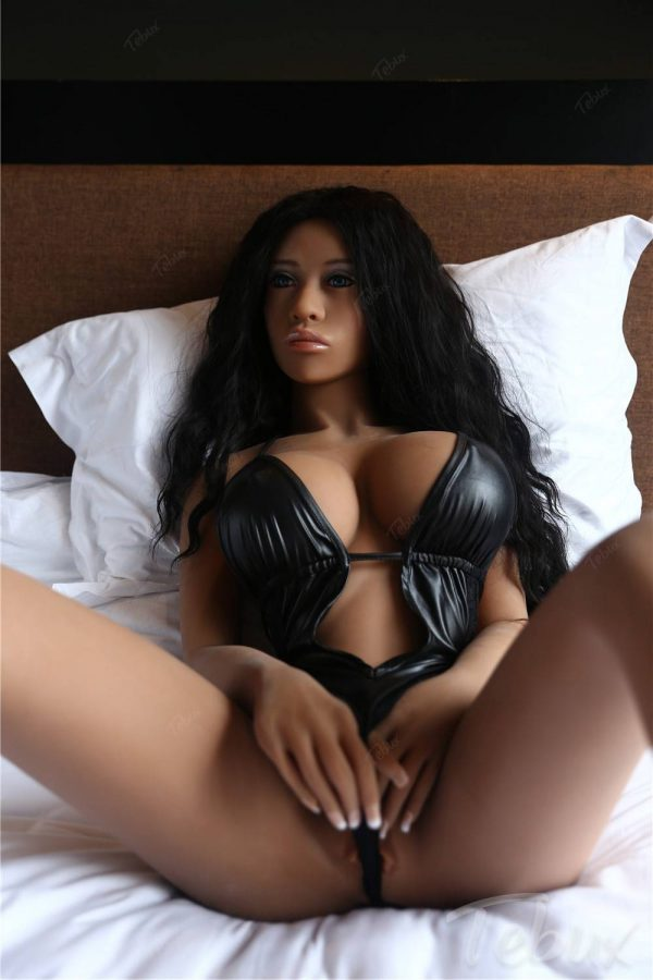 Latina sex doll lying in black lingerie