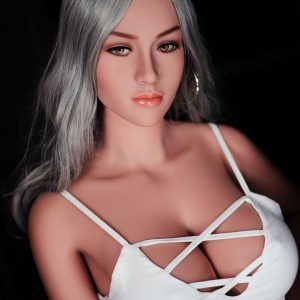 Life-like sex doll sitting wearing white dress
