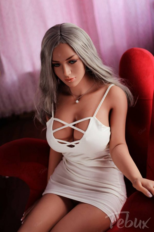 Life-like sex doll wearing white dress