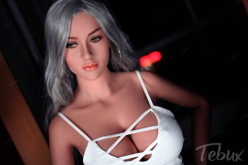 Life-like sex doll wearing white dress