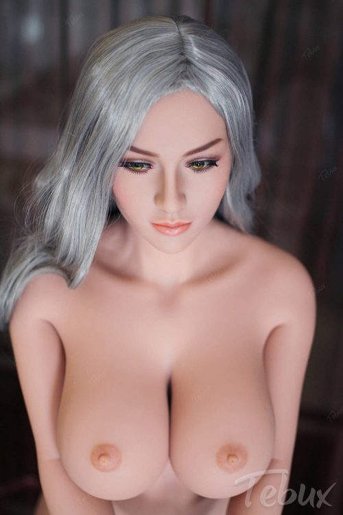 Life-like sex doll standing naked