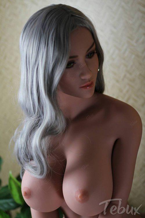 Life-like sex doll sitting naked