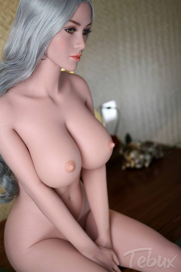 Life-like sex doll sitting naked