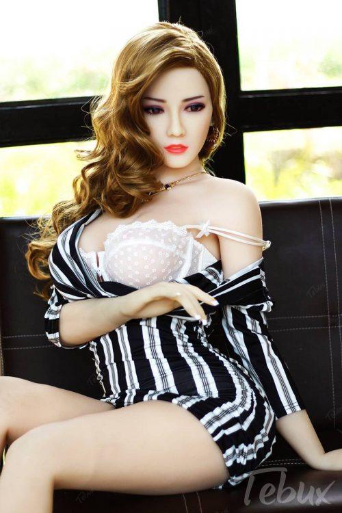 Life like sex doll sitting wearing white lingerie