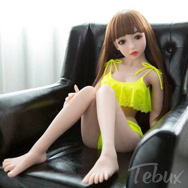 lifelike sexdolls like Kennedy sitting in yellow bikini