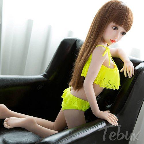 lifelike sexdolls like Kennedy kneeling in yellow bikini