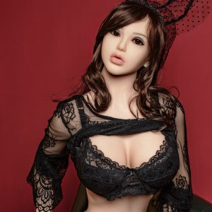 Love sex doll sitting wearing black lingerie