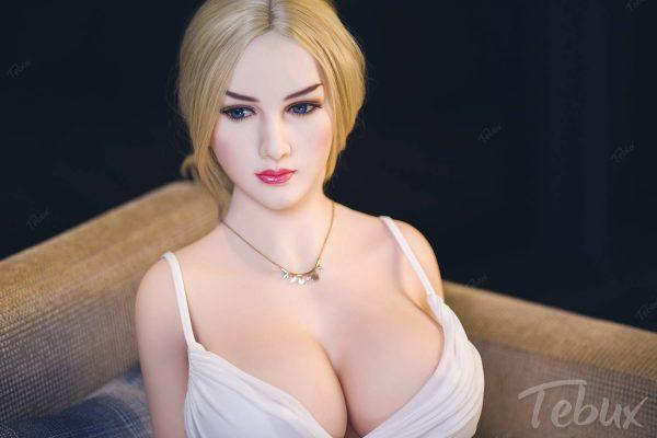 Mature sex dolls like Karla in white dress sitting