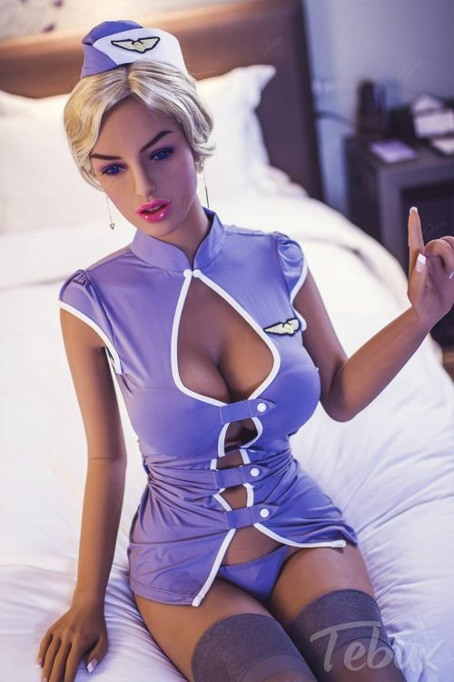 Milf sex doll sitting down on bed