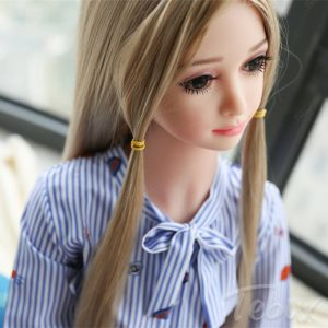 Mini sex doll Stella standing in dress