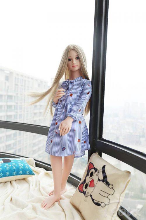 Mini sex doll Stella standing in dress