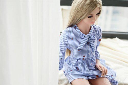 Mini sex doll Stella sitting in dress
