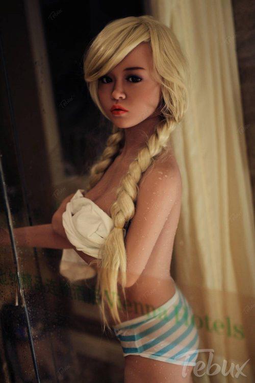 Petite sex doll standing