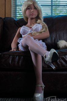 Petite sex doll sitting wearing lingerie