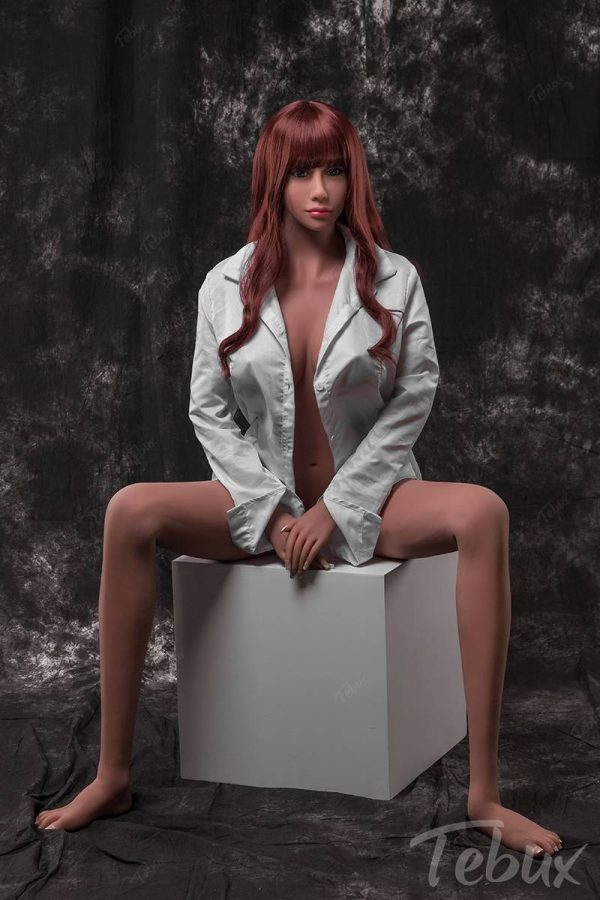 Real life sexdoll Lilly sitting in white shirt